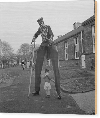 Henry The Stilt Man Wood Print by John Drysdale