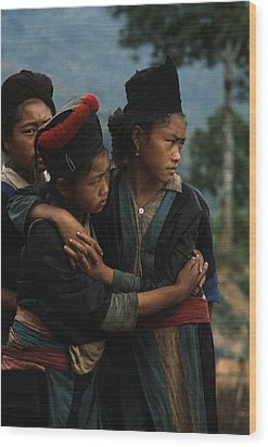 Hmong Girls Cling To Each Other Wood Print by W.E. Garrett