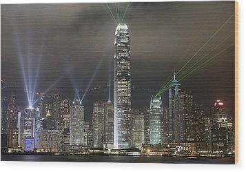 Hong Kong Light Show, At Night, Over Wood Print by Axiom Photographic