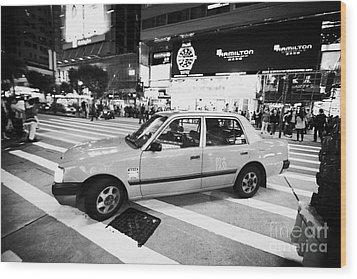 Hong Kong Red Taxi At Night On Nathan Road Downtown Kowloon Hong Kong Hksar China Wood Print by Joe Fox