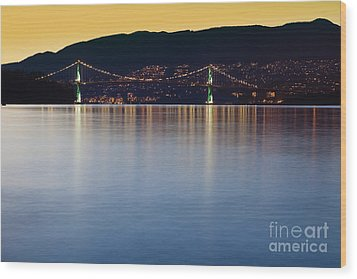 Illuminated Bridge Across A Bay Wood Print by Bryan Mullennix