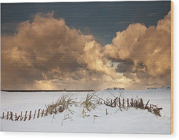 Illuminated Clouds Glowing Above A Wood Print by John Short