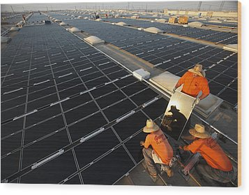 Installing Photovoltaic Panels Wood Print by Michael Melford