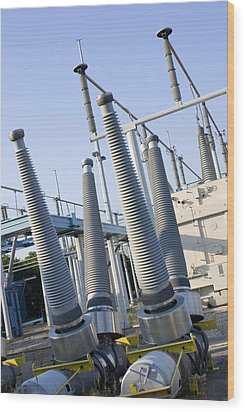 Insulators At Electricity Substation Wood Print by Mark Williamson