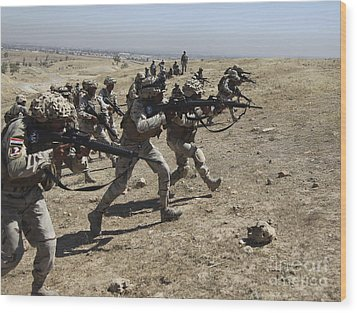 Iraqi Army Soldiers Move To Positions Wood Print by Stocktrek Images
