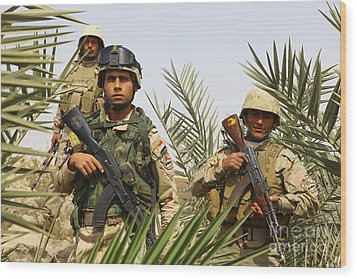 Iraqi Soldiers Conduct A Foot Patrol Wood Print by Stocktrek Images