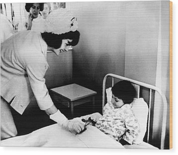 Jacqueline Kennedy Left, Presents Wood Print by Everett