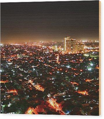Jakarta At Night Wood Print by Simonlong