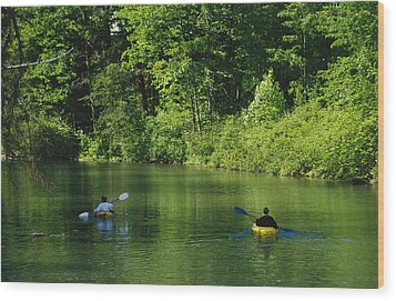Kayakers Paddle In The Headwaters Wood Print by Raymond Gehman