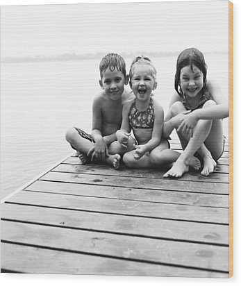 Kids Sitting On Dock Wood Print by Michelle Quance