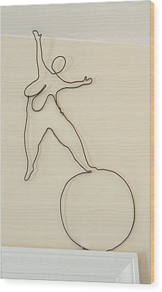 Lady With 1 Foot On The Ball   Wood Print by Tommy  Urbans