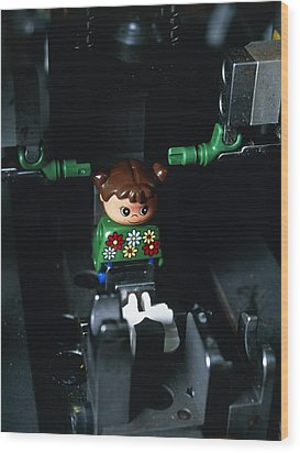 Lego Doll In An Assembly Machine Wood Print by Volker Steger