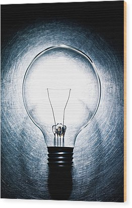 Light Bulb On Stainless Steel Background. Wood Print by Ballyscanlon