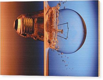 Light Bulb Shot Into Water Wood Print by Setsiri Silapasuwanchai
