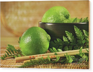 Limes With Chopsticks Wood Print by Sandra Cunningham