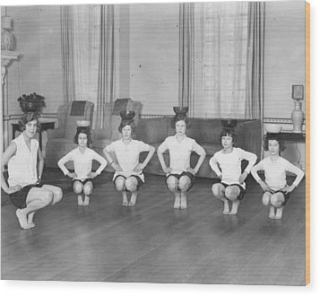 Line Of Girls (7-12) Exercising With Bowls On Heads (b&w) Wood Print by Hulton Archive
