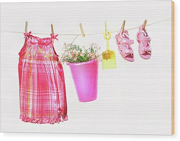 Little Girl Clothes And Toys On A Clothesline Wood Print by Sandra Cunningham