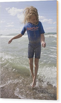 Little Girl Jumping In The Surf In Lake Michigan Wood Print by Christopher Purcell