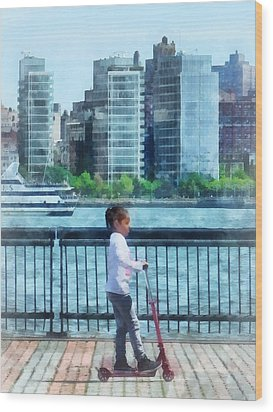 Little Girl On Scooter By Manhattan Skyline Wood Print by Susan Savad
