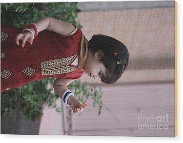 Little Girl With Flower Wood Print by Muhammad Junaid Rashid