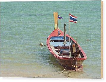 Longtail Boat At Sea Wood Print by Bill Brennan