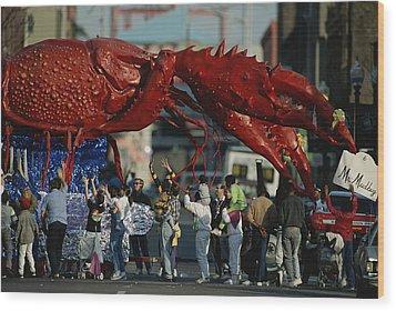 Louisianans Revel Beneath A Giant Wood Print by Joel Sartore