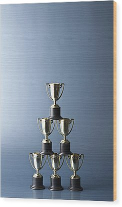 Loving Cup Trophies Stacked In A Pyramid Wood Print by Larry Washburn