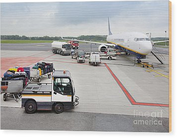 Luggage Transported To An Airprot Wood Print by Jaak Nilson