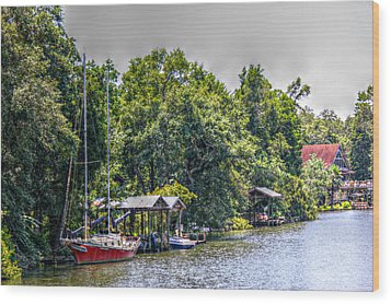 Magnolia River With A Red Sailboat Wood Print