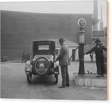 Man Fueling His Car At A Self-service Wood Print by Everett