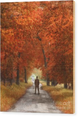 Man In Suit On Rural Road In Autumn Wood Print by Jill Battaglia