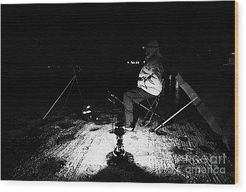 Man Nighttime Fishing Wood Print by Joe Fox