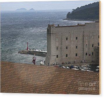 Man On The Roof In Dubrovnik Wood Print by Madeline Ellis