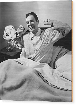 Man Stretching In Bed, (b&w), Wood Print by George Marks
