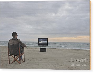 Man Watching Tv On Beach At Sunset Wood Print by Sami Sarkis