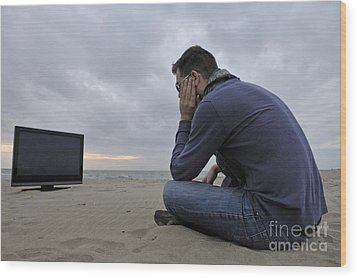 Man With Tv On Beach At Sunset Wood Print by Sami Sarkis