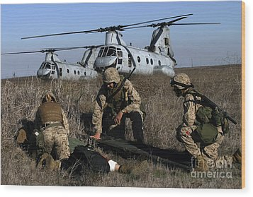 Marines And Sailors Being Transported Wood Print by Stocktrek Images