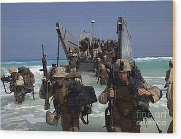 Marines Disembark A Landing Craft Wood Print by Stocktrek Images
