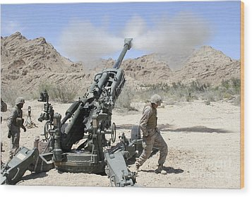 Marines Shoot 100-pound Rounds Wood Print by Stocktrek Images