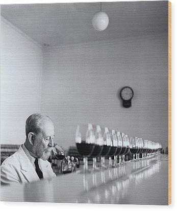 Mature Wine Tester With Row Of Glasses (b&w) Wood Print by Hulton Archive
