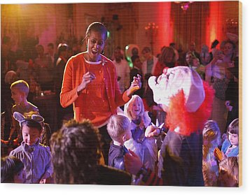 Michelle Obama Dancing With Children Wood Print by Everett