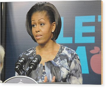 Michelle Obama Presents The Childhood Wood Print by Everett