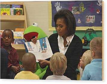 Michelle Obama Reads The Cat In The Hat Wood Print by Everett