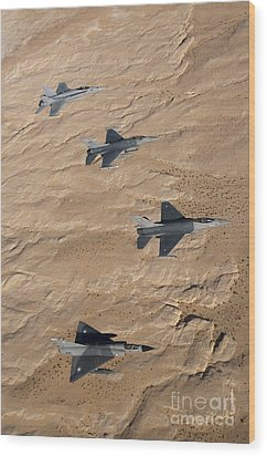 Military Fighter Jets Fly In Formation Wood Print by Stocktrek Images