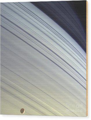 Mimas Drifts Along In Its Orbit Wood Print by Stocktrek Images
