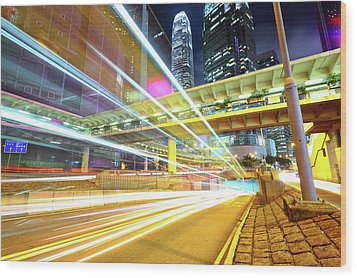 Modern City At Night Wood Print by Leung Cho Pan