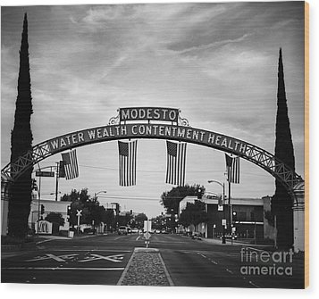 Modesto Arch With Flags Wood Print by Jim And Emily Bush