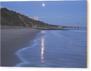 Moon Reflecting In The Sea, Bournemouth Beach, Dorset, England, Uk Wood Print by Peter Lewis