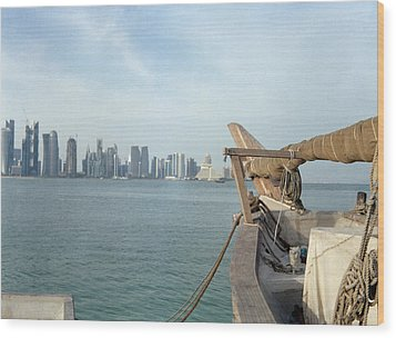 Moored Dhow And Doha Wood Print by Paul Cowan