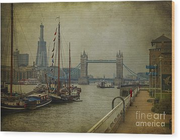 Wood Print featuring the photograph Moored Thames Barges. by Clare Bambers